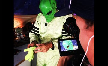 The My Home, NC camera gets a closer look at Reynolds as he dons his Frisco UFO alien outfit.