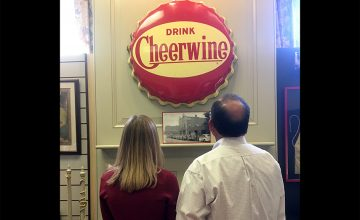 Cheerwine Marketing Director Joy Ritchie-Harper and Cliff Harper, president and CEO of Carolina Beverage Corp. and Cheerwine Bottling Co., look at a relic on display at the Rowan museum. The museum is recognizing the 100-year anniversary of Cheerwine with a year-long exhibit.