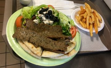 A popular main dish at International Delights, the gyro platter, is prepared and ready to serve with a side of fries.