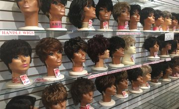 Brunette Wigs — Over 600 wigs are on display at Kim's Wig Center, ranging from electric pink hues to these short-cropped shades of brunette.