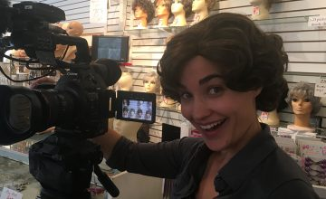 My Home, NC's Miriam McSpadden strikes a pose in a short, wavy wig at Kim's Wig Center in Asheville.