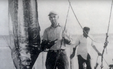 Captain Ernal Foster pictured next to a massively impressive catch of the day, circa 1937.