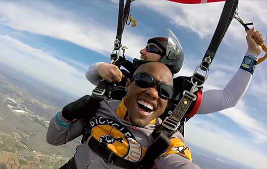 When Davian Robinson isn't breaking barriers for the disabled in the dance community, he's breaking barriers on other adventures. Here he's seen taking a selfie while skydiving.
