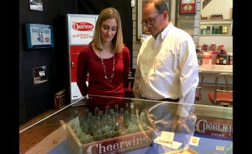 Joy Ritchie-Harper and Cliff Ritchie, members of the founding Cheerwine family, find a taste of nostalgia while looking at the Rowan museum's Cheerwine exhibit.