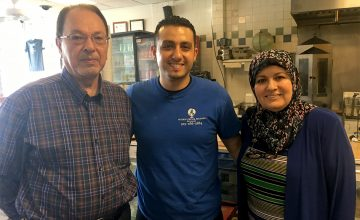 (From left) Gehad Lobbad, Emad Lubbad and Zakie Moukanna pose for a photo inside their restaurant International Delights, which has brought American, Greek and Mediterranean cuisine to Ninth St. in Durham for 25 years.