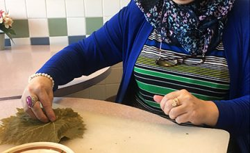 A popular item on the menu at International Delights are the grape leaves, one of the Zakie's recipes. Here she prepares the mixture and rolls it into the grape leaves.