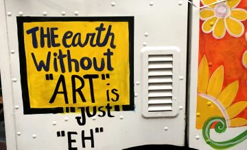 Painted on the side of the Red Calaca art truck is the phrase
